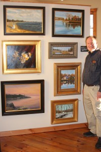 """""""Dan and his wall of paintings at Voila Gallery, Wickford, RI"""