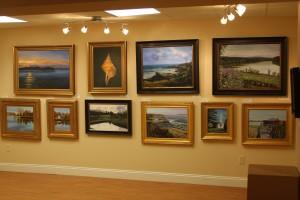 A wall of Dan's paintings at Lemon 'n Lyme